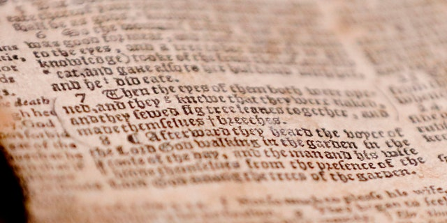 """The word """"breeches"""" is visible as the last word in verse 7 of chapter 3 in Genesis in the theft recovered Bible shown during a news conference, Thursday, April 25, 2019, in Pittsburgh. The word gives the 1615 Breeches Edition Bible that stolen from the Carnegie Library in Pittsburgh in the 1990's its name. The stolen Bible was traced to the American Pilgrim Museum in Leiden, Netherlands. (AP Photo/Keith Srakocic)"""