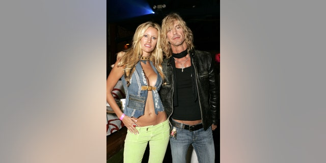 """Susan Holmes and Duff McKagan during Rip Curl Present """"Sand & Glam"""" Benefiting Heal the Bay - Inside at Club 1650 in Hollywood. (Photo by Chris Weeks/WireImage)"""