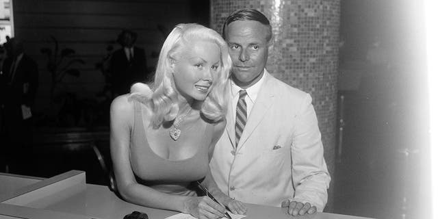 Joi Lansing and Stan Todd getting their marriage license in 1960.