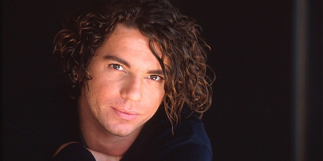 Michael Hutchence of INXS, studio portrait, London, 1990. — Photo by Michael Putland/Getty Images