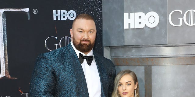 """Hafthor Julius Bjornsson and Kelsey Henson attend the premiere of """"Game of Thrones"""" at Radio City Music Hall on April 3, 2019 in New York City."""