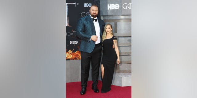 "Hafthor Julius Bjornsson and Kelsey Henson attend the premiere of ""Game of Thrones"" at Radio City Music Hall on April 3, 2019 in New York City."