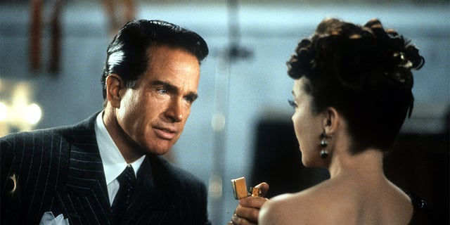 """Warren Beatty and Annette Bening in a scene from the film """"Bugsy,"""" 1991. —Photo by TriStar Pictures/Getty Images"""