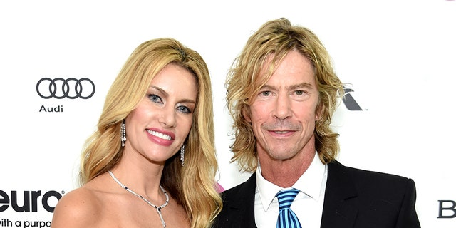 Susan Holmes and musician Duff McKagan attend the 24th Annual Elton John AIDS Foundation's Oscar Viewing Party at The City of West Hollywood Park on Feb. 28, 2016 in West Hollywood, Calif. (Jamie McCarthy/Getty Images for EJAF)