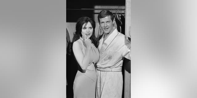Roger Moore and Madeline Smith. Photo by Terry O'Neill/Iconic Images/Getty Images