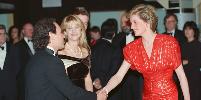 "The Princess of Wales, Princess Diana, attends the Premiere of ""When Harry Met Sally..."" in London's West End. The Princess, wearing a Bruce Oldfield red chiffon dress embroidered in a tartan design in silver Lam, talks to American actors Meg Ryan and actor Billy Crystal who star in the film, 30th November 1989. — Photo by Kent Gavin/Daily Mirror/Mirrorpix/Getty Images"