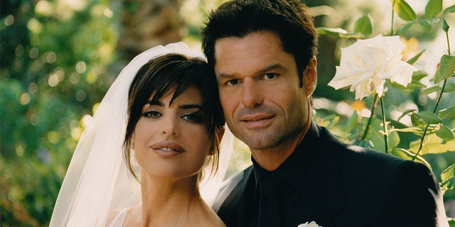 BEVERLY HILLS, CA - MARCH 29: Actors Lisa Rinna and Harry Hamlin pose for a photo after their wedding at their home on March 29, 1997 in Beverly Hills, California. — Photo by Roxanne McCann/Getty Images