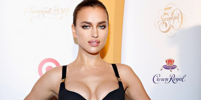 Irina Shayk attends as Captain Morgan White Rum and Crown Royal XO raise a glass to the Sports Illustrated Swimsuit 50 Years of Swim Issue at the Sports Illustrated Swimsuit Beach House on February 18, 2014 in New York City.