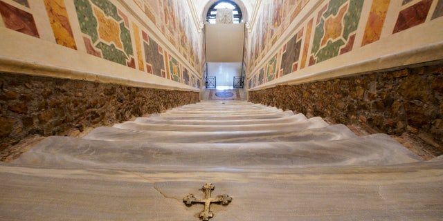 A view of the newly restored Holy Stairs (Scala Sancta), which according to Catholic Church is the stair on which Jesus Christ stepped leading on his way to the crucifixion, during a special opening, in Rome, Thursday, April 11, 2019. (AP Photo/Andrew Medichini)