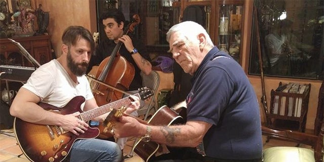 R. Lee Ermey learned to play guitar in his later years. — Courtesy of Betty Ermey
