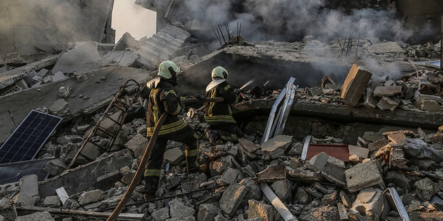 22 March 2019, Syria, Idlib: Members of the Syrian civil defense extinguish a fire in a house allegedly targeted by an airstrike in the town of Kafraya in the north of Idlib. According to activists 10 people died in airstrikes allegedly carried out by Russian warplanes.