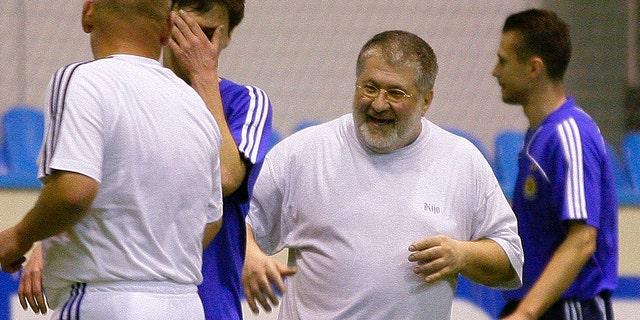 In this photo taken in Feb. 26, 2010, Ukrainian a self-exiled billionaire businessman Ihor Kolomoyskyi, center, plays soccer in Kiev, Ukraine. (AP Photo/Andriy Lukatsky, File)