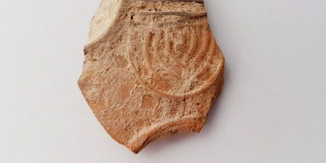 Oil lamp sherd decorated with a nine-branched menorah