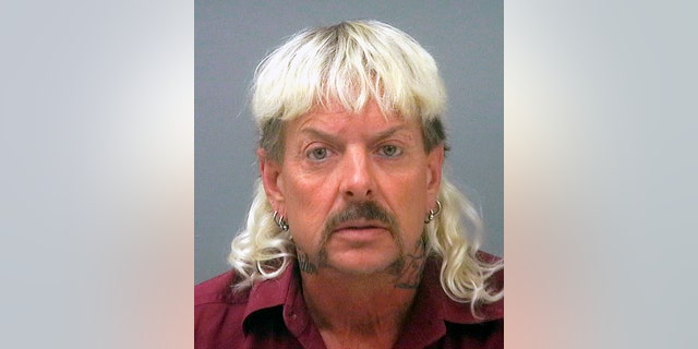 This file photo provided by the Santa Rose County Jail in Milton, Fla., shows Joseph Maldonado-Passage. Prosecutors say Maldonado-Passage, also known as Joe Exotic, tried to arrange the killing of Carole Baskin, the founder of Big Cat Rescue.