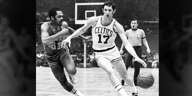 FILE - In this Jan. 8, 1970 file photo, Boston Celtics' John Havlicek (17) protects ball with his body from Atlanta Hawks' Walt Hazzard (42) during an NBA basketball game in Boston. (Associated Press)