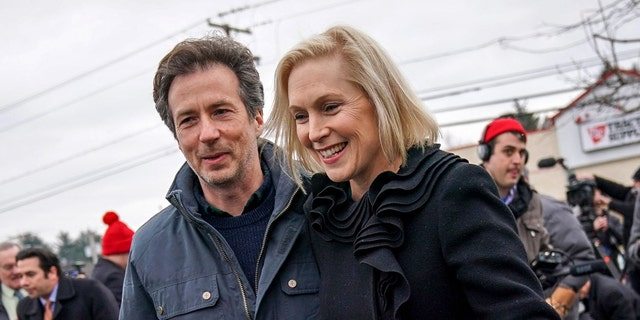 Sen. Kirsten Gillibrand and her husband Jonathan Gillibrand walk together after a media availability announcing she will run for president in 2020 outside the Country View Diner, January 16, 2019 in Troy, New York. (Photo by Drew Angerer/Getty Images)