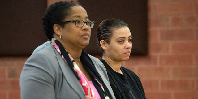 Katiria Tirado, 33, right, the Hartford mother charged in the death of her 17-year-old autistic son, Matthew Tirado, appears in Hartford Superior Court on Tuesday, March 21, 2017.