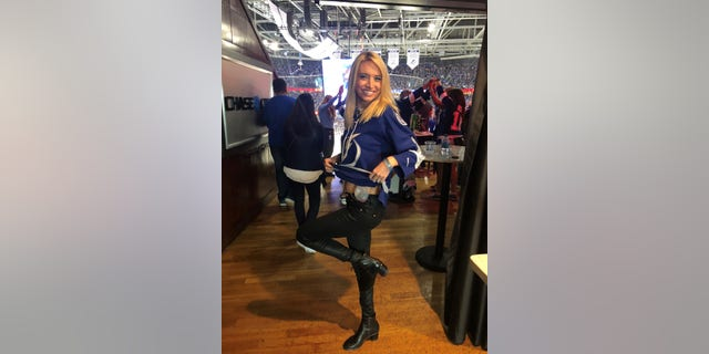The author at a Tampa Bay LIghtning hockey game four days after her preventative double mastectomy at age 30 on May 1, 2018.