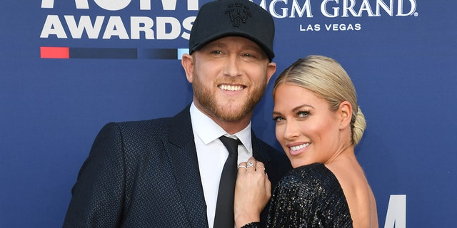 Cole Swindell (L) and Barbie Blank attend the 54th Academy Of Country Music Awards at MGM Grand Garden Arena on April 07, 2019 in Las Vegas, Nevada.