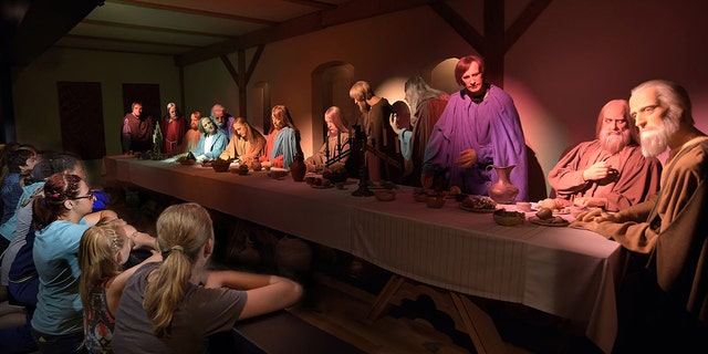 "Visitors view the ""Last Supper"" at the BibleWalk wax museum in Mansfield, Ohio."