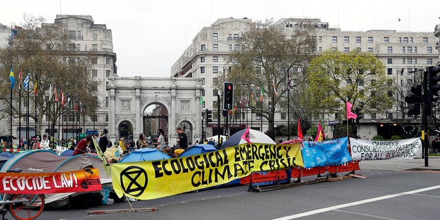 The road is blocked by demonstrators during a climate protest at Marble Arch in London, Tuesday, April 16, 2019. The group Extinction Rebellion is calling for a week of civil disobedience against what it says is the failure to tackle the causes of climate change.