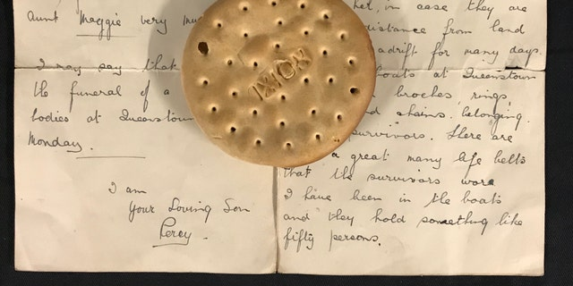 The hardtack ship's biscuit and the letter describing its discovery. (Henry Aldridge and Son)