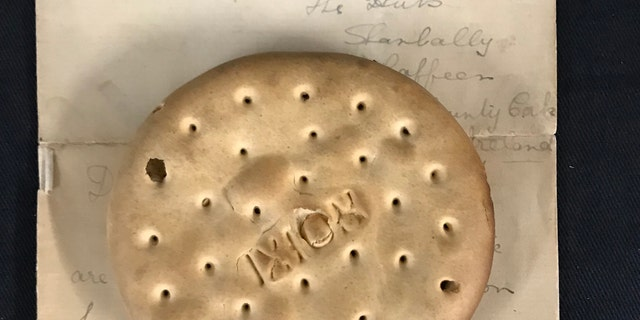 The hardtack biscuit was recovered from one of Lusitania's lifeboats. (Henry Aldridgeand Son)