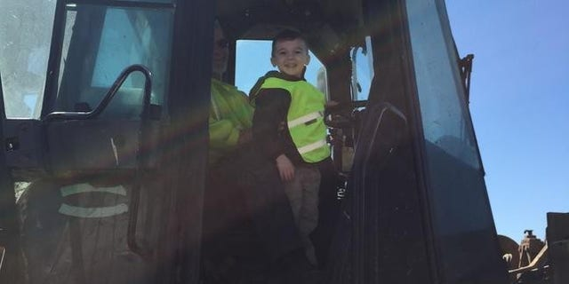 Pictures from Ethan's big day also show him touring the area's local Waste Management facility.