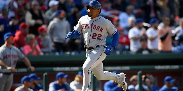 New York Mets' Dominic Smith runs toward home to score on a single by Robinson Cano during the eighth inning of a baseball game against the Washington Nationals, Thursday, March 28, 2019, in Washington.