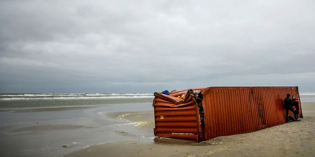 Volunteers clean up the coastline after goods from shipping containers of the vessel MSC Zoe washed up on the shores of Schiermonnikoog island, on Jan. 4, 2019. The MSC Zoe, which was mostly carrying toys, furniture and auto parts, lost the containers late on January 1, 2019, while battling a storm off the Frisian Islands, an archipelago off the northwestern Dutch coast also known as the Wadden Islands.