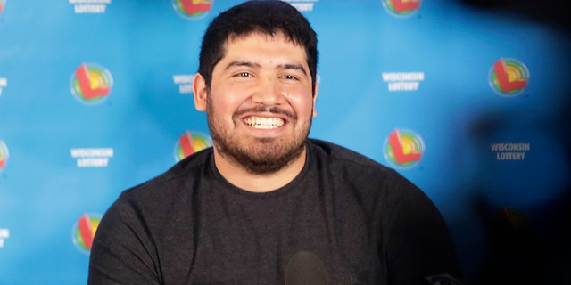 Manuel Franco of West Allis, Wis., claimed the cash option payout of the prize, totaling approximately $477 million before taxes. (John Hart/Wisconsin State Journal via AP)