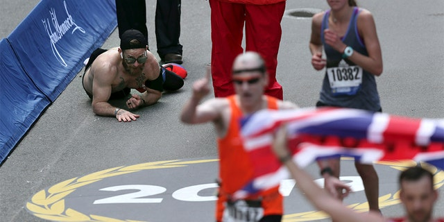 Micah Herndon, of Tallmadge, Ohio, crawls to the finish line in the 123rd Boston Marathon on Monday, April 15, 2019, in Boston. (AP Photo/Charles Krupa)