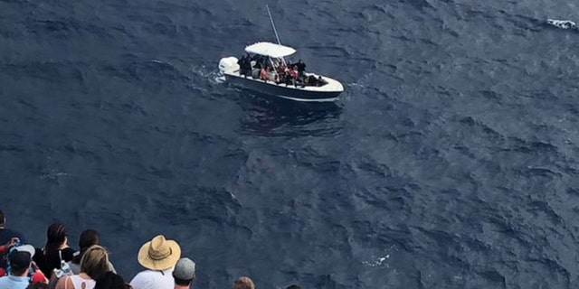 Hours later, a Coast Guard helicopter successfully located the crowded barge around 8:40 a.m., and notified officials with the Carnival Fantasy of its position, Fox 10 reports. Soon after, around 10:40 a.m., the Fantasy rescued the 23 people on board.