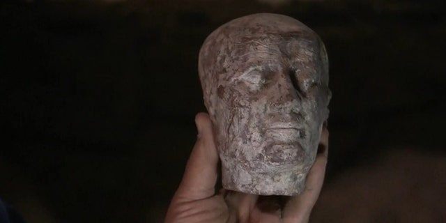 """Archaeologists also discovered a 2,500-year-old wax head, which is thought to be a cast of High Priest """"Irt Hrw."""" (Discovery Channel)"""