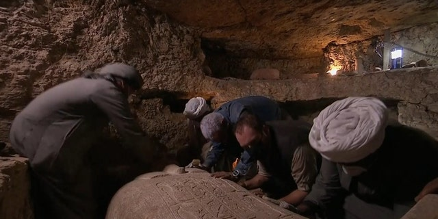 Archaeologists opened a sealed stone sarcophagus to discover the high priest's mummified remains. (Discovery Channel)