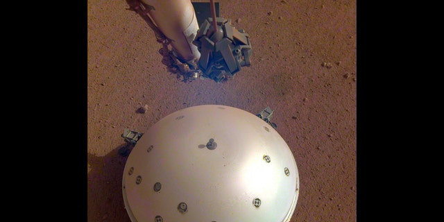 This image of InSight's seismometer was taken on the 110th Martian day, or sol, of the mission. The seismometer is called Seismic Experiment for Interior Structure, or SEIS. (Credit: NASA/JPL-Caltech)