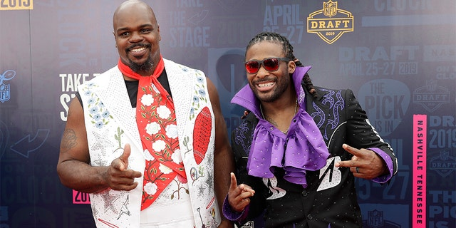 Vince Wilfork, left and DeAngelo Willimas travel a red runner forward of a initial turn during a NFL football draft, Thursday in Nashville, Tenn. (AP Photo/Mark Humphrey)