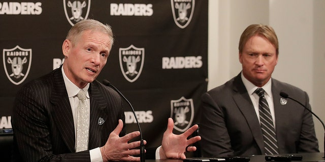 Mike Mayock speaks as Oakland Raiders head coach Jon Gruden listens during a news conference on Dec. 31, 2018. (AP Photo/Jeff Chiu, File)