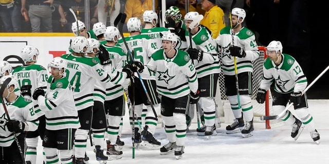 The Dallas Stars celebrate after defeating the Nashville Predators 3-2 in Game 1 of an NHL hockey first-round playoff series Thursday, April 11, 2019, in Nashville, Tenn. (AP Photo/Mark Humphrey)