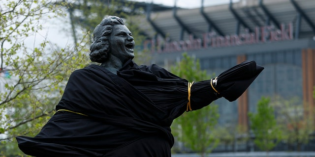 A partially covered statue of singer Kate Smith is seen near the Wells Fargo Center, Friday, April 19, 2019, in Philadelphia. (AP Photo/Matt Slocum)