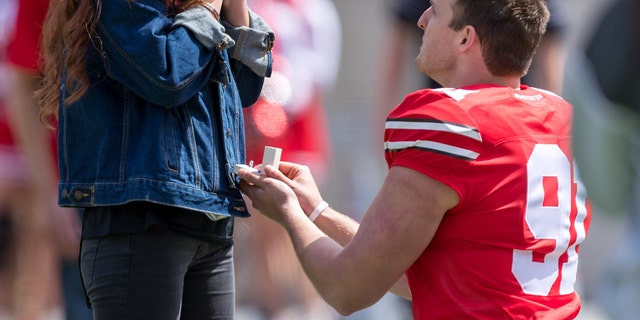 Westlake Legal Group OhioStateProposalAdamLacyIcon-Sportswirevia-GettyImages Ohio State punter proposes to girlfriend during halftime kicking 'contest': 'It worked out perfectly' Michael Bartiromo fox-news/sports fox-news/lifestyle/relationships fox news fnc/lifestyle fnc article 62885609-e484-53c9-8e61-4f858e7b2210