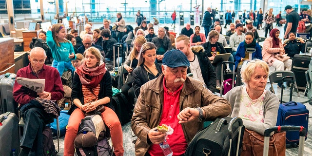 Travellers wait during a strike of Scandinavian Airlines' (SAS) pilots on April 26, 2019 at the Gardamoen Airport in Oslo, Norway.