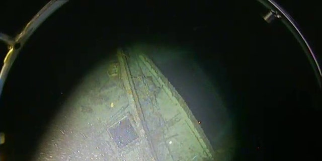 Debris can be seen on the SS Iron Crown's bow near the ship's open cargo hold.