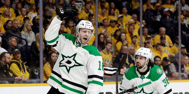 Dallas Stars center Jason Dickinson (16) celebrates after scoring a goal against the Nashville Predators during the first period in Game 5 of an NHL hockey first-round playoff series Saturday, April 20, 2019, in Nashville, Tenn. (AP Photo/Mark Humphrey)