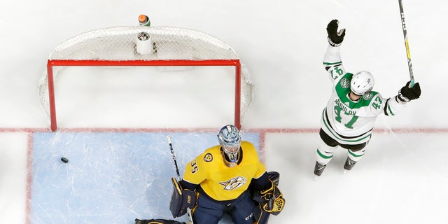 Dallas Stars right wing Alexander Radulov (47), of Russia, reacts after scoring his second goal against Nashville Predators goaltender Pekka Rinne (35), of Finland, during the second period in Game 5 of an NHL hockey first-round playoff series Saturday, April 20, 2019, in Nashville, Tenn. (AP Photo/Mark Humphrey)