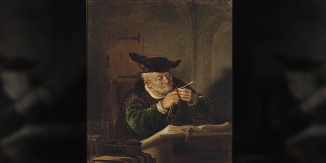 """United States Attorney for the Southern District of New York Geoffrey Berman presented Salomon Koninck's 1639 piece, """"A Scholar Sharpening His Quill,"""" to the family of renowned art collector Adolphe Schloss - decades after it was taken from his collection in 1943."""