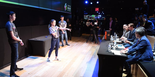 Students Jonah Hoffman, Paige Tayloe and Trey Fisher of Owensville High School in Owensville, Missouri present their STEM project to judges at the Samsung Solve for Tomorrow National Finalist Pitch Event on Monday, April 1, 2019 in New York City (Samsung)