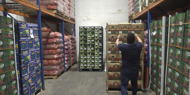 Carlos Ayala, Amore Produce owner, shows Fox News produce refrigerated stockroom