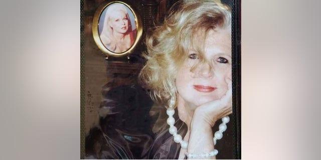 Alexis Hunter today posing alongside a portrait of Joi Lansing. — Courtesy of Alexis Hunter