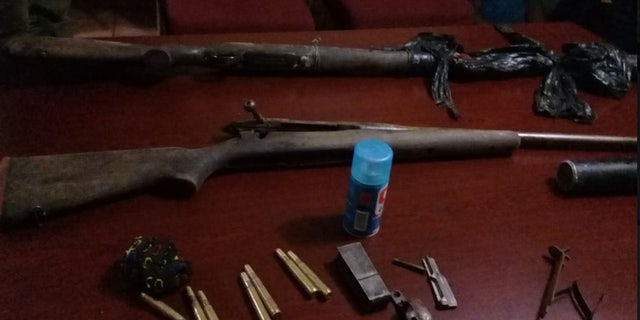 Rifles and ammunition were discovered after a poacher was reportedly killed by an elephant.